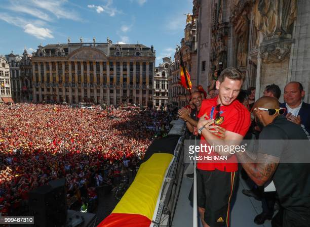 Belgium's Jan Vertonghen and Belgium's assistant coach Thierry Henry celebrate at the Grand Place/Grote Markt in Brussels city center as Belgian...