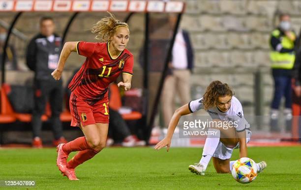 Belgium's Janice Cayman and Albania's Alma Hila pictured in action during a soccer game between Belgium's national team the Red Flames and Albania,...
