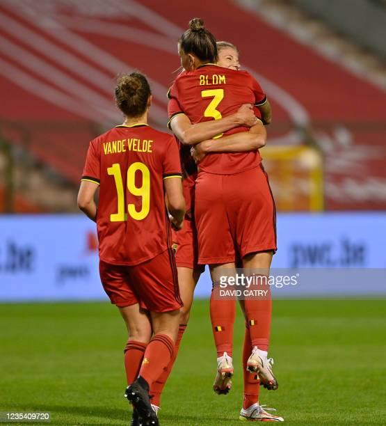 Belgium's Jassina Blom celebrates after scoring during, with and Belgium's Justine Vanhaevermaet a soccer game between Belgium's national team the...