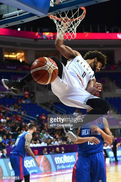 Belgium's Jean Marc Nwema scores next to Great Britain's Luke Nelson during the FIBA Eurobasket 2017 men's group D basketball match between Belgium...