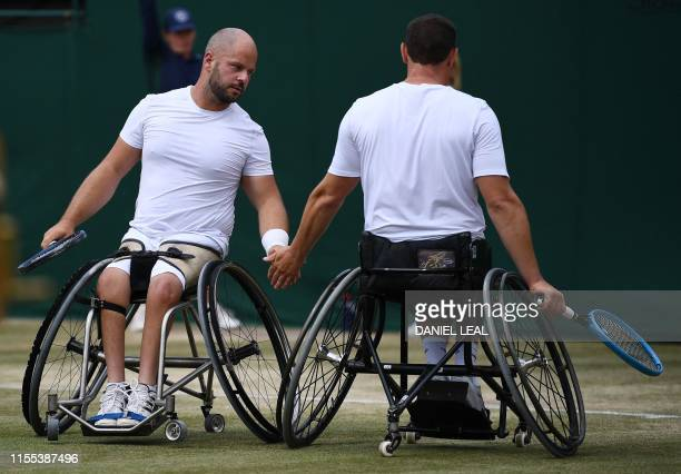 Belgium's Joachim Gerard and Sweden's Stefan Olsson celebrate after winning a point against Britain's Gordon Reid and Alfie Hewett during their men's...