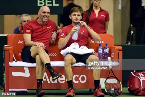 Belgium's Johan Van Herck speaks with Belgium's David Goffin during the single match of the Davis Cup World first round between Belgium and Hungary...