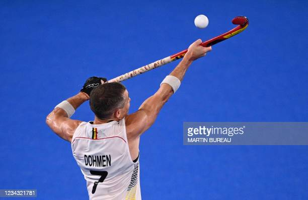 Belgium's John-John Dominique Dohmen controls the ball during the men's pool B match of the Tokyo 2020 Olympic Games field hockey competition against...