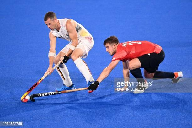 Belgium's John-John Dominique Dohmen is tackled by Britain's Liam Paul Ansell during their men's pool B match of the Tokyo 2020 Olympic Games field...