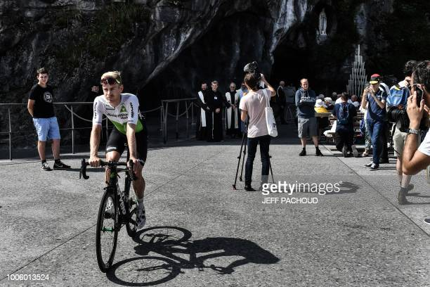 TOPSHOT Belgium's Julien Vermote leaves on his bicycle after attending a blessing ceremony at the catholic shrine of Lourdes the Grotto of...
