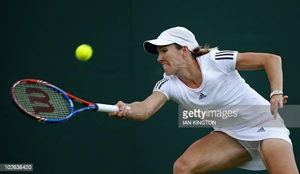 Belgium's Justin Henin returns a ball to Latvia's Anastasija Sevastova during the Wimbledon Tennis Championships at the All England Tennis Club in...