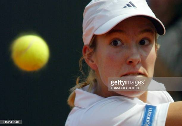 Belgium's Justine Henin-Hardenne eyes the ball during a Roland Garros French Tennis Open second round match against her Croatian opponent Jelena...