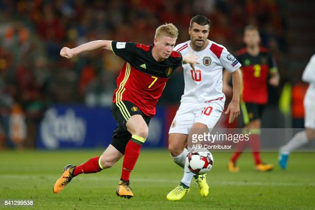 Belgium's Kevin De Bruyne outruns Gibraltar's Liam Walker during the WC 2018 football qualification football match between Belgium and Gibraltar at...