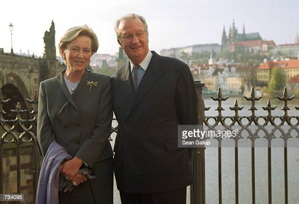 Belgium's King Albert II and his wife Queen Paola pose for a picture October 24 2000 in front of the Charles Bridge and Prague Castle in Prague Czech...