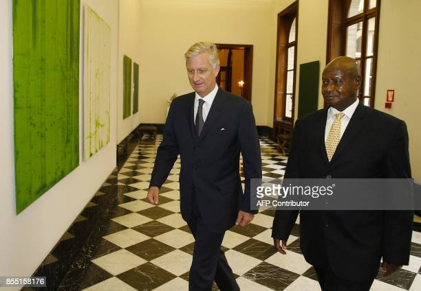 Belgium's King Philippe and President of Uganda Yoweri Kaguta Museveni walk ahead of a meeting at The Royal Palace in Brussels on September 28 2017 /...