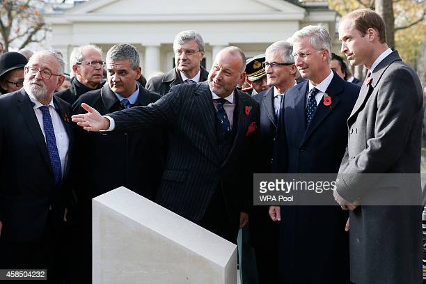 Belgium's King Philippe and Prince William Duke of Cambridge look at the Flanders' Fields Memorial Garden during its opening at Wellington Barracks...