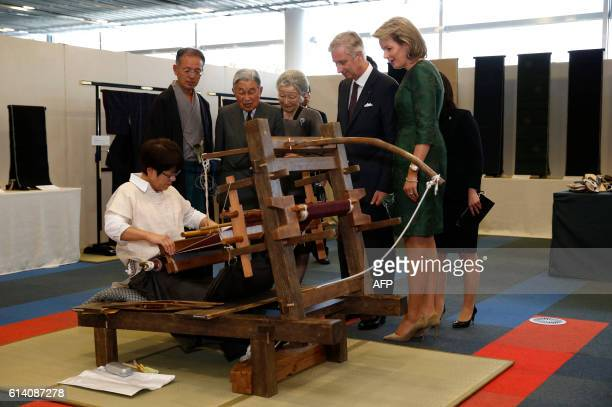 Belgium's King Philippe and Queen Mathilde and Japan's Emperor Akihito and Empress Michiko look at a demonstration to create a traditional woven silk...