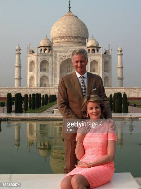 Belgium's King Philippe and Queen Mathilde pose for photographers as they visit the Taj Mahal in Agra on November 6 2017 Belgium's King Philippe and...
