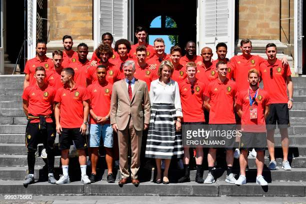 Belgium's King Philippe Filip of Belgium and Queen Mathilde of Belgium pose for a picture with Belgium's team players forward Thorgan Hazard forward...