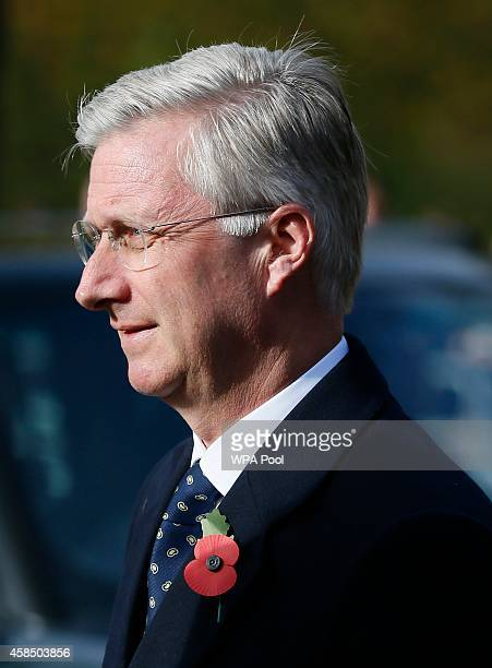 Belgium's King Philippe holds a wreath during the Opening of the Flanders' Fields Memorial Garden at Wellington Barracks on November 6 2014 in London...