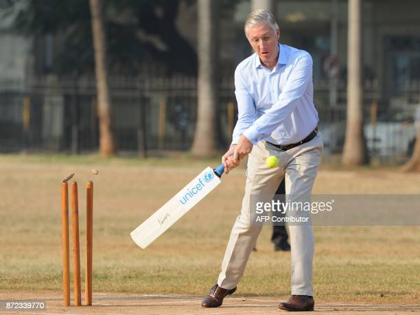 Belgium's King Philippe plays a shot during a UNICEF cricket clinic at The Oval maidan in Mumbai on November 10 2017 Belgium's King Philippe and...