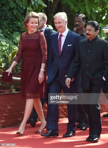 Belgium's King Philippe Queen Mathilde and the Governor of the western Indian state of Maharashtra Ch Vidyasagar Rao walk during an event at the...