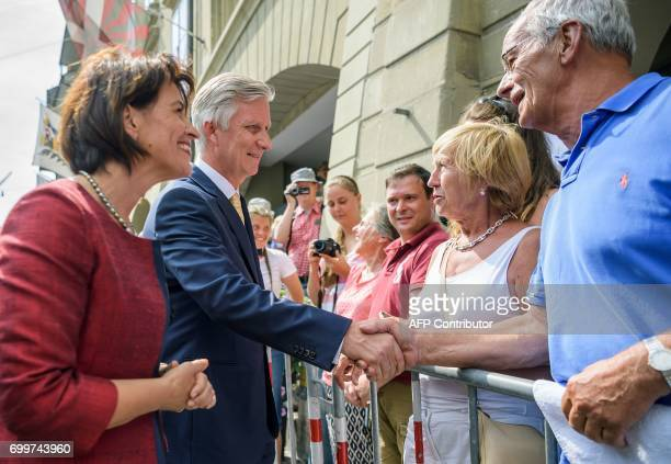Belgium's King Philippe shakes hands with members of the public next to Switzerland's President Doris Leuthard at the start of an official visit on...