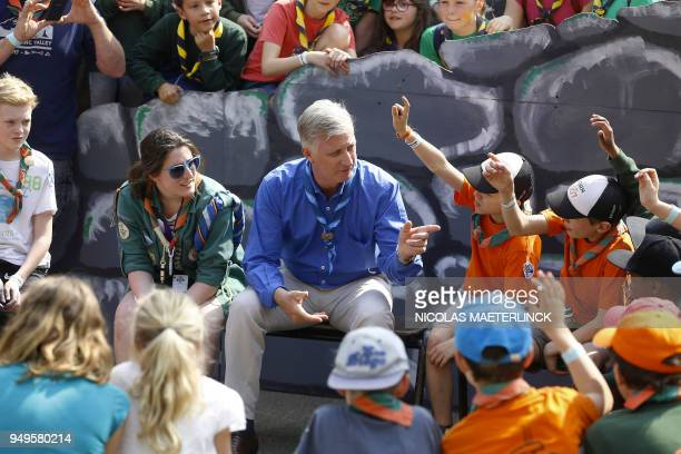 Belgium's King Philippe visits children during the BeSCOUT gathering on April 21 2018 in LouvainlaNeuve The BeSCOUT is a gathering of about 25000...