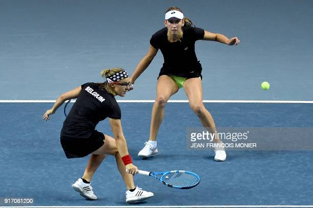 Belgium's Kirsten Flipkens and Belgium's Elise Mertens returns the ball to France's Kristina Mladenovic and France's Amandine Hesse during the Fed...