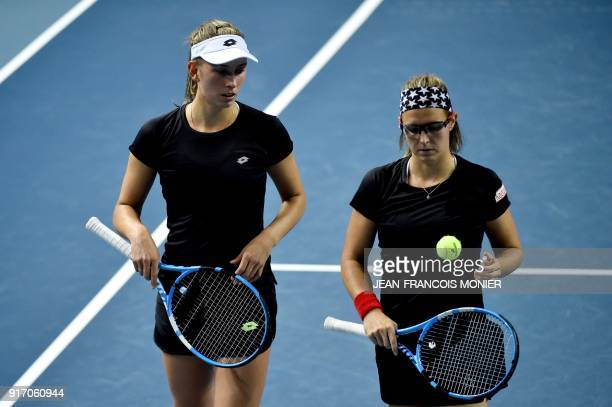 Belgium's Kirsten Flipkens and Belgium's Elise Mertens talk during their double tennis match against France's Kristina Mladenovic and France's...