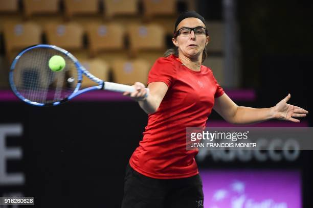 Belgium's Kirsten Flipkens returns a ball during a training session ahead the Fed Cup World Group first round tennis match between France and Belgium...