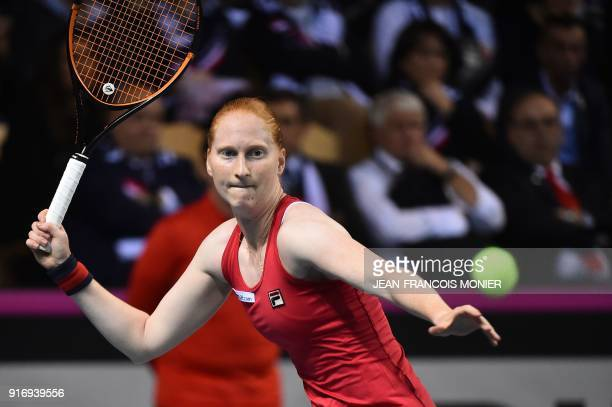 Belgium's Kirsten Flipkens returns to France's Pauline Parmentier during the Tennis Fed Cup world group first round match between France and Belgium...