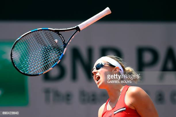 TOPSHOT Belgium's Kirsten Flipkens throws her racket during her tennis match against Australia's Samantha Stosur at the Roland Garros 2017 French...