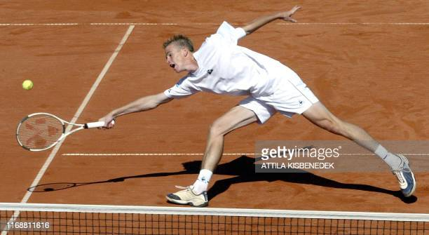 Belgium's Kristof Vliegen stretches for the ball during the Davis cup pair match against Austria, 20 September 2003 in the Werzer Arena on the second...