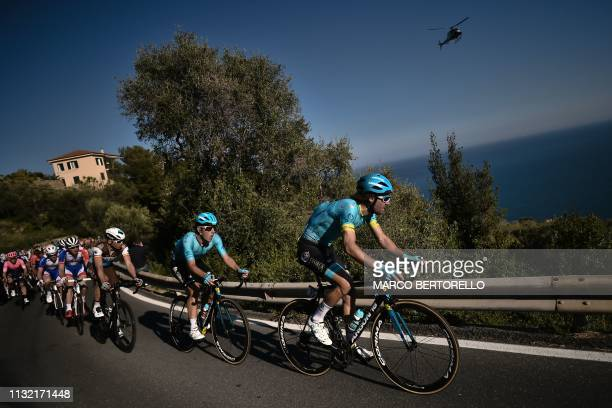 TOPSHOT Belgium's Laurens De Vreese and the pack ride in the Cipressa ascent during the oneday classic cycling race Milan San Remo on March 23 2019