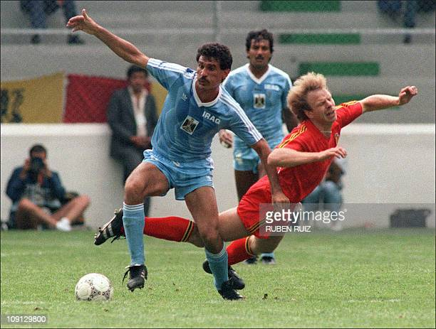 Belgium's Leo Clysters grimaces with pain as he falls after being tackled by Iraqi forward Ahmed 08 June 1986 in Toluca during a group B match of the...