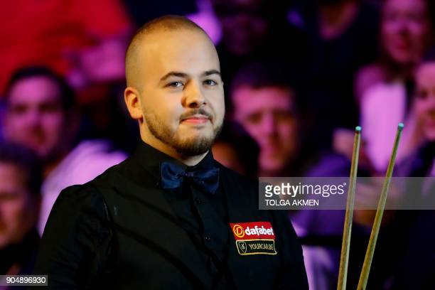 Belgium's Luca Brecel arrives to play against Northern Ireland's Mark Allen during their firstround match in the Masters snooker tournament at...