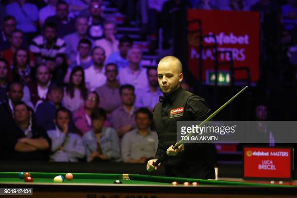 Belgium's Luca Brecel considers a shot against Northern Ireland's Mark Allen during their firstround match in the Masters snooker tournament at...