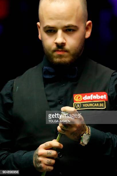 Belgium's Luca Brecel contemplates a shot against Northern Ireland's Mark Allen during their firstround match in the Masters snooker tournament at...