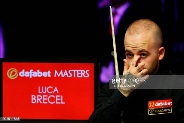 Belgium's Luca Brecel looks on from his seat during his firstround match against Northern Ireland's Mark Allen in the Masters snooker tournament at...