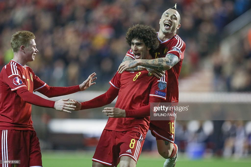 Belgium's Marouane Fellaini (C) celebrates with Kevin De Bruyne (L) and Radja Nainggolan after scoring during the Euro 2016 qualifying round football match between Belgium and Cyprus at the King Baudouin stadium in Brussels on March 28, 2015.