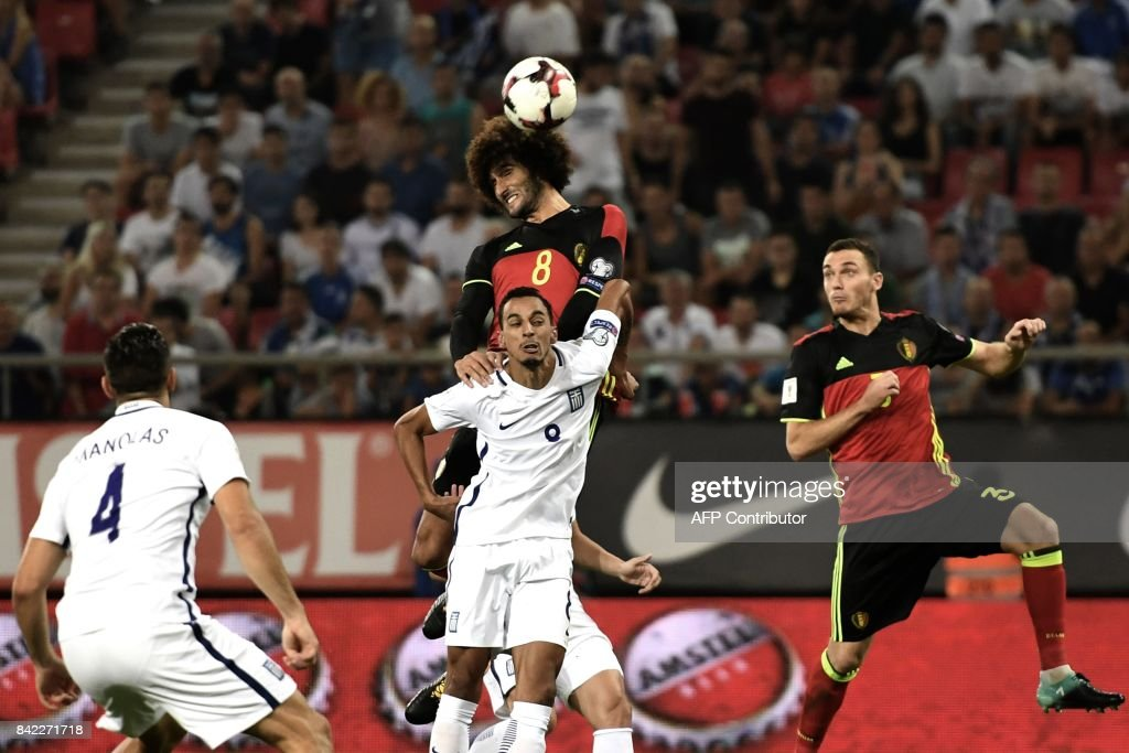 Belgium's Marouane Fellaini (TOP) fights for the ball with Greece's Zeca during their Group H 2018 FIFA World Cup qualifying football match between Greece and Belgium at The Georgios Karaiskakis Stadium in Piraeus near Athens on September 3, 2017. /