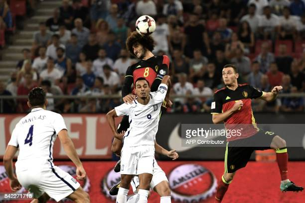Belgium's Marouane Fellaini fights for the ball with Greece's Zeca during their Group H 2018 FIFA World Cup qualifying football match between Greece...