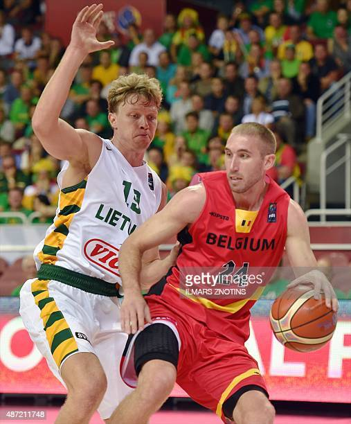 Belgium's Matt Lojeski vies for the ball with Lithuania's Mindaugas Kuzminskas during the Eurobasket 2015 group D basketball match Lithuania vs...