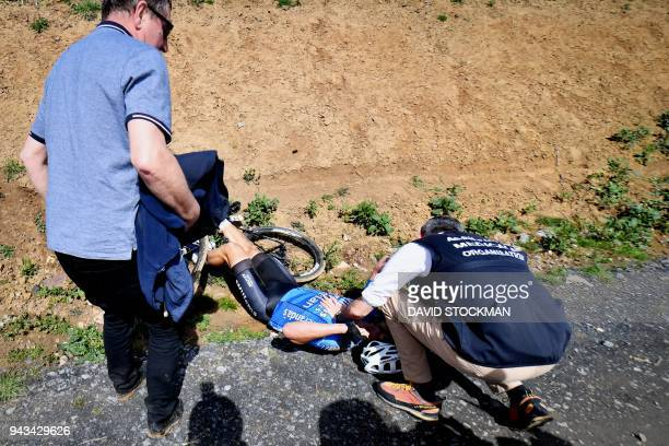 Belgium's Michael Goolaerts of Veranda's WillemsCrelan cycling team receives first aid after a crash during the 116th edition of the ParisRoubaix...