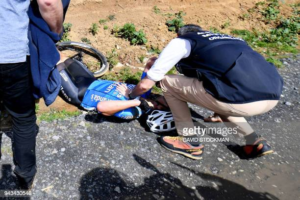 TOPSHOT Belgium's Michael Goolaerts of Veranda's WillemsCrelan cycling team receives first aid after a crash during the 116th edition of the...