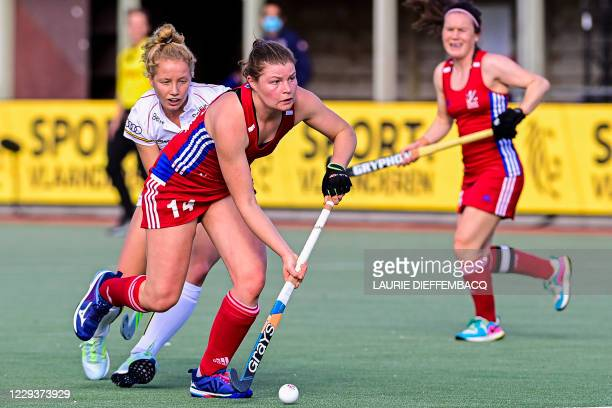 Belgium's Michelle Struijk and Britain's Tess Howard fight for the ball during a hockey game between the Belgian Red Panthers and Great Britain's...
