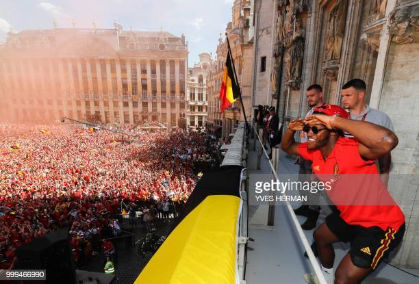 Belgium's Michy Batshuayi celebrates at the Grand Place/Grote Markt in Brussels city center as Belgian national football team Red Devils arrive to...