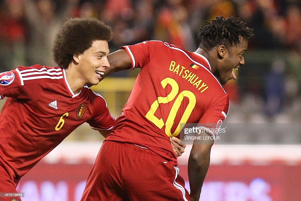 Belgium's Michy Batshuayi (R) celebrates with Axel Witsel after scoring during the Euro 2016 qualifying round football match between Belgium and Cyprus at the King Baudouin stadium in Brussels on March 28, 2015.