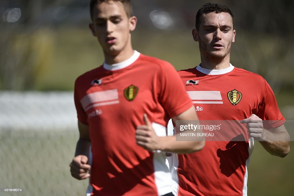 Belgium's midfielder Adnan Januzaj (L) and Belgium's defender Thomas Vermaelen attend a training session during the 2014 FIFA World Cup in Mogi das Cruzes on July 3, 2014.