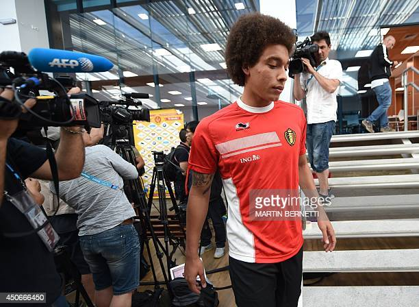Belgium's midfielder Axel Witsel walks to the field after a press conference before a team training session at SESC Venda Nova in Belo Horizonte on...