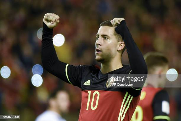Belgium's midfielder Eden Hazard celebrates after scoring a penalty during the FIFA World Cup 2018 qualification football match between Belgium and...