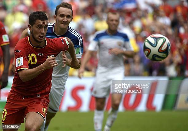 Belgium's midfielder Eden Hazard vies for the ball with Russia's defender Aleksei Kozlov during a Group H football match between Belgium and Russia...