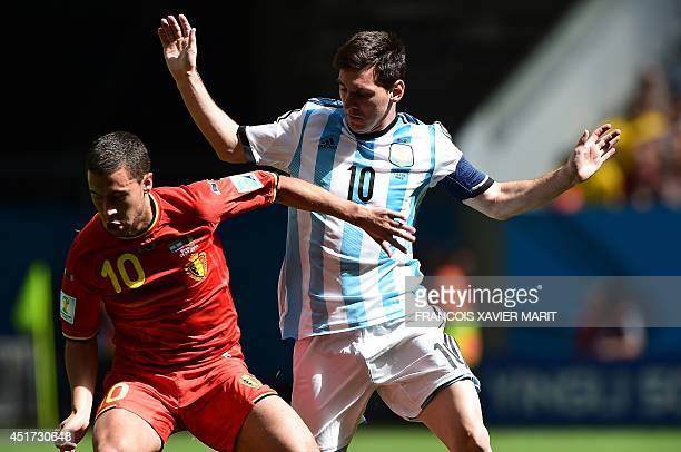 Belgium's midfielder Eden Hazard vies with Argentina's forward Lionel Messi during the second half of a quarterfinal football match between Argentina...