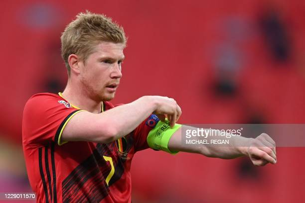Belgium's midfielder Kevin De Bruyne adjusts his captain's armband during the UEFA Nations League group A2 football match between England and Belgium...